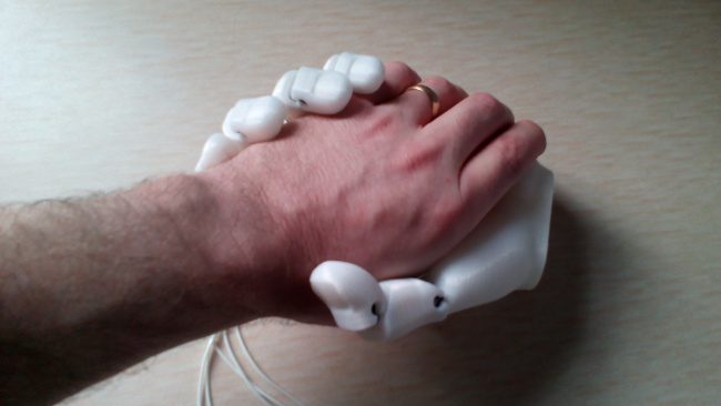 A human hand shaking a 3D Printed prosthetic one
