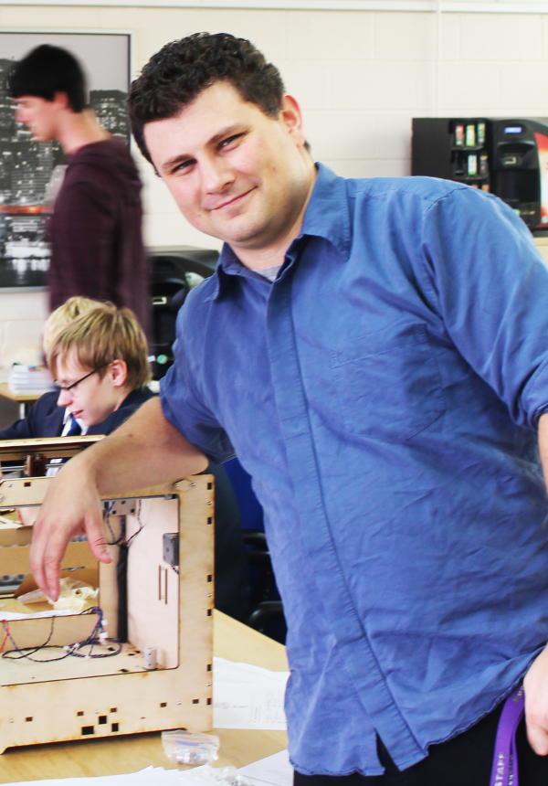 Ted Turnbull of Fareham College standing next to a 3D printer