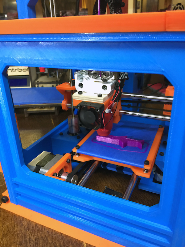 MaplePrint Mini 3D printer printing.